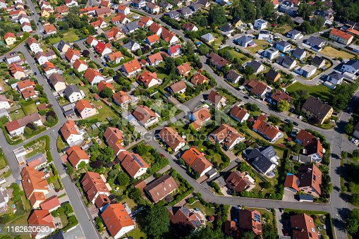 Aerial view above suburb homes in residential neighborhood.