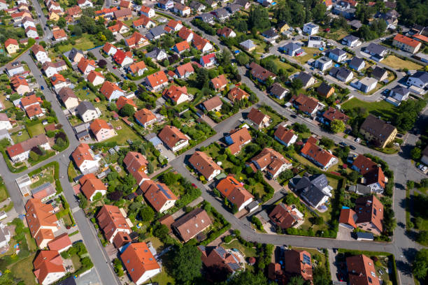 Aerial view above suburb houses Aerial view above suburb homes in residential neighborhood. residential district stock pictures, royalty-free photos & images