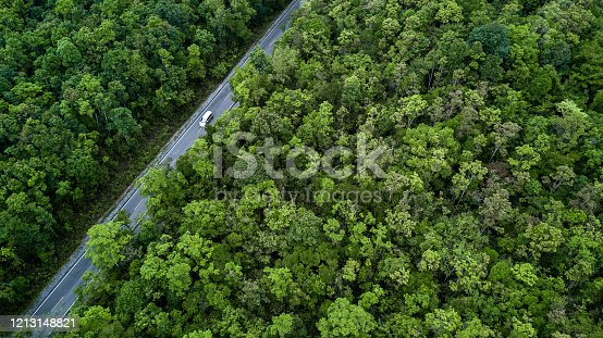 1042711480 istock photo Aerial view asphalt road and green forest, Forest road going through forest with car adventure view from above, Ecosystem and ecology healthy environment concepts and background. 1213148821