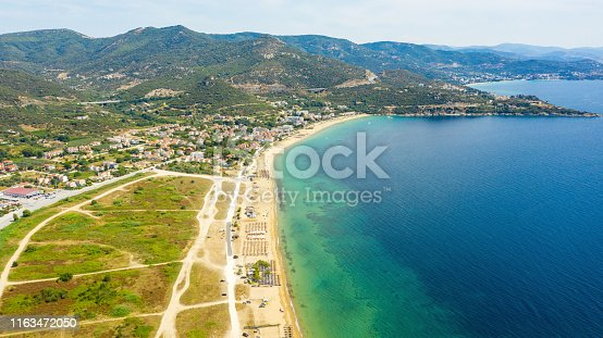 811600544 istock photo Aerial view at the beach. Beautiful natural seascape at the summer time. 1163472050
