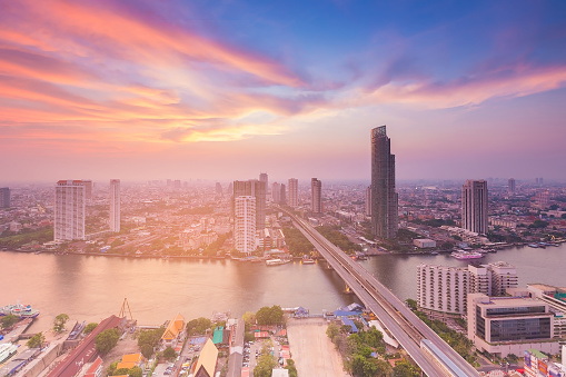 istock Aerial view Bangkok city with river and beauty sunset sky background 827067608