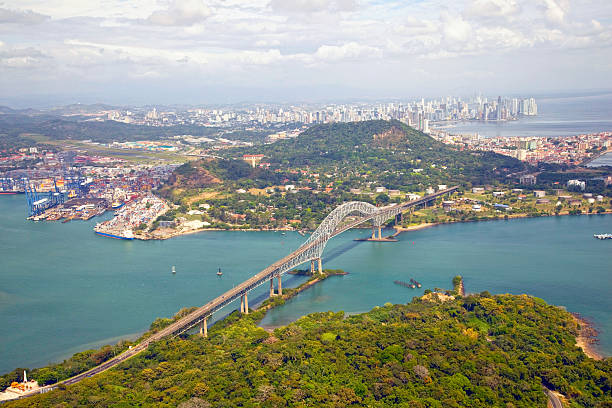 Aerial view; Bridge of the Americas, Panama Aerial view of the Bridge of the Americas at the Pacific entrance to the Panama Canal with Panama City in the background. sea channel stock pictures, royalty-free photos & images