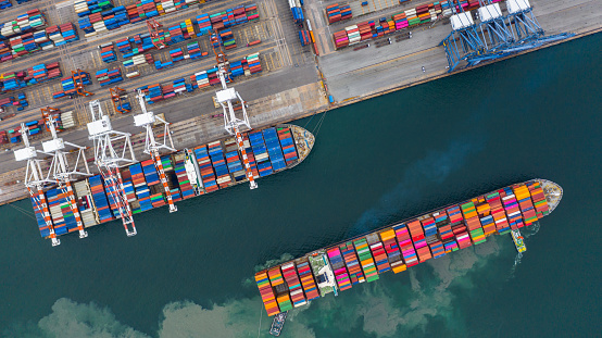 Aerial View Cargo Ship Terminal Unloading Crane Of Cargo Ship Terminal Aerial View Industrial Port With Containers And Container Ship Stock Photo - Download Image Now