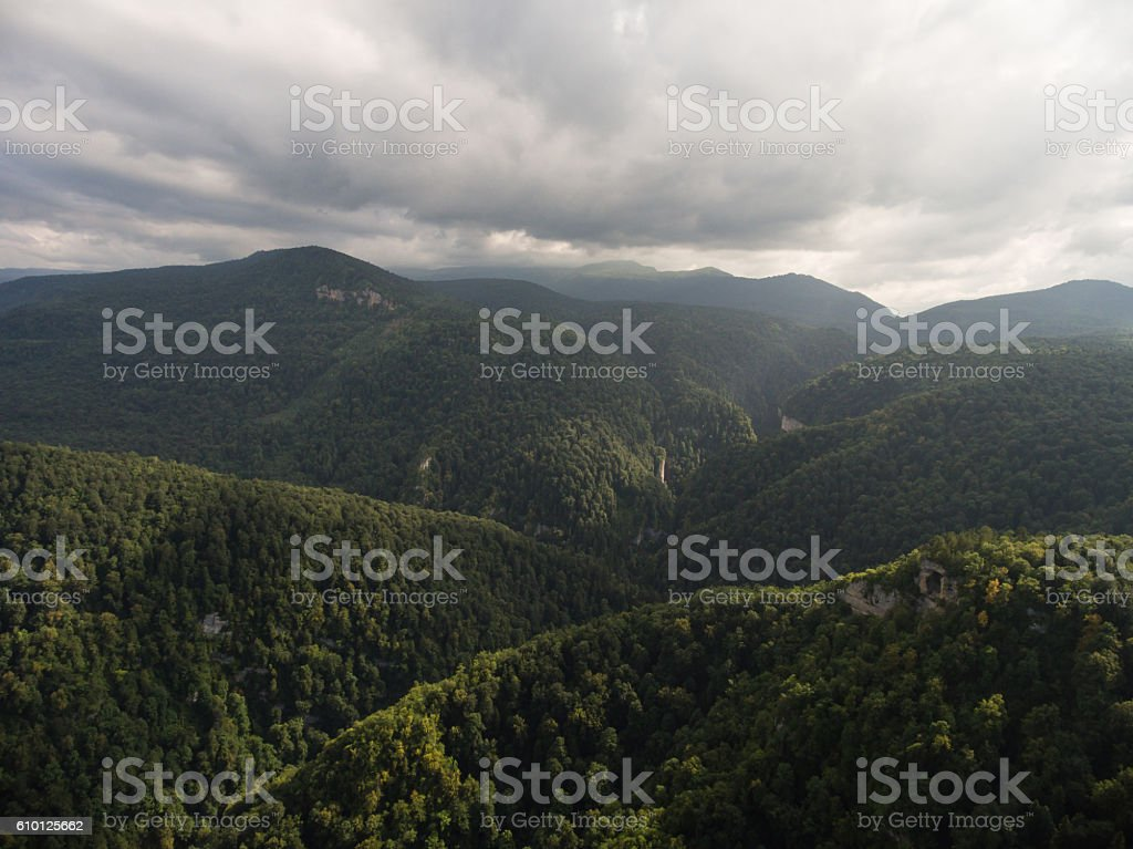 Aerial view. Caucasus Mountains under gloomy cloudy sky. stock photo
