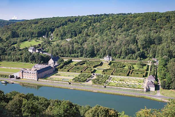 aerial view chateau freyr along river meuse near dinant, belgium - maasvallei stockfoto's en -beelden