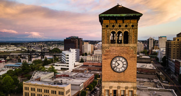 Aerial View City Clocktower in Downtown Tacoma Washington Mt Rainier can be seen in the background at sunset in Tacoma Washington USA tacoma stock pictures, royalty-free photos & images