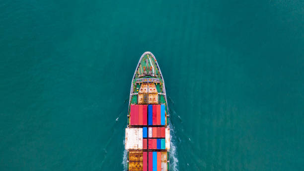 Aerial view container ship carrying container for import and export, business logistic and freight transportation by ship in open sea. Aerial view container ship carrying container for import and export, business logistic and freight transportation by ship in open sea. container ship stock pictures, royalty-free photos & images
