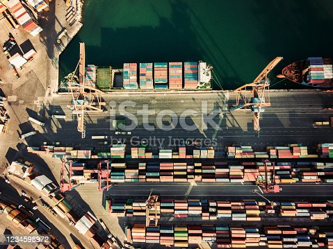 Aerial view container ship from sea port working for delivery containers shipment.