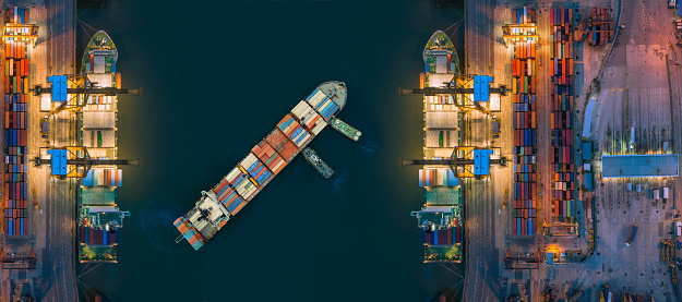 637816284 istock photo Aerial view container ship from sea port working for delivery containers shipment. Suitable use for transport or import export to global logistics concept. 1025243978