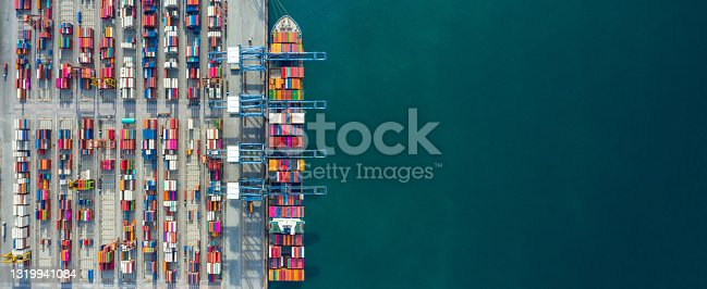istock Aerial view container ship in port at container terminal port, Ship of container ship stand in terminal port on loading, unloading container, Commercial cargo ship in sea port. 1319941084