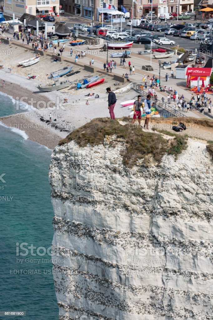 Aerial view daredevil standing at high cliff in Normandy, France stock photo