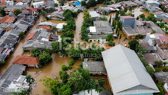 istock Aerial POV view Depiction of flooding. devastation wrought after massive natural disasters 1225349990