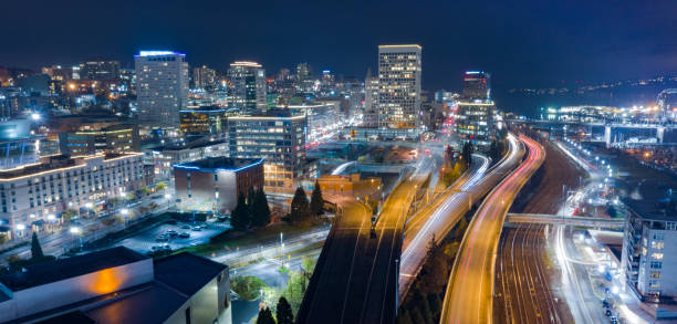 Aerial View Downtown Urban City Center Core Skyline Tacoma WA Night scene aerial view over the highway and buildings of downtown Tacoma Washington pierce county washington state stock pictures, royalty-free photos & images