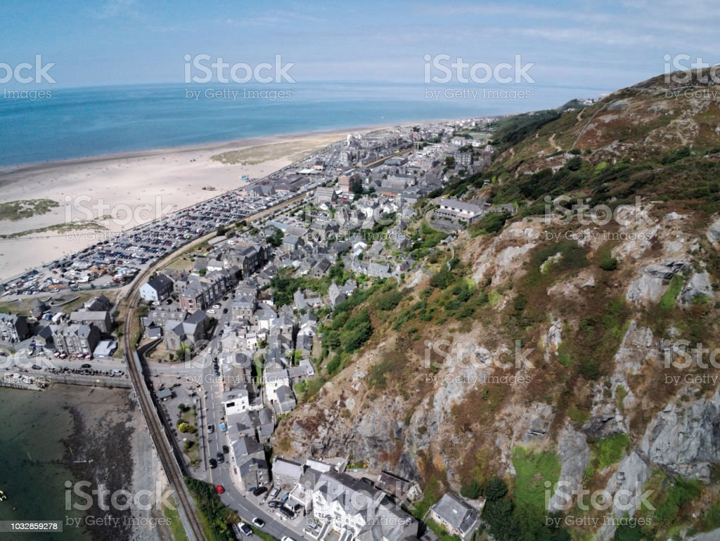 Aerial view, Drone panorama over buildings, railway line, road, beach and old town of Barmouth, Wales stock photo