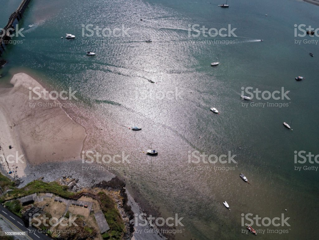 Aerial view, Drone panorama over sea, anchored yachts and beach over Mawddach river in Barmouth, Wales stock photo