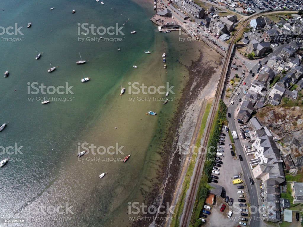 Aerial view, Drone top down panorama over buildings, railway line, road, beach and old town of Barmouth, Wales stock photo