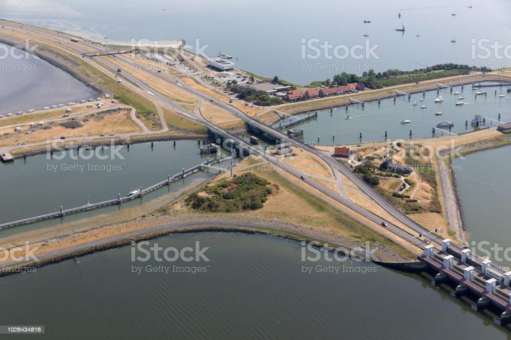 Luchtfoto Nederlandse sluizen van Kornwerderzand tussen IJsselmeer en Waddenzee foto