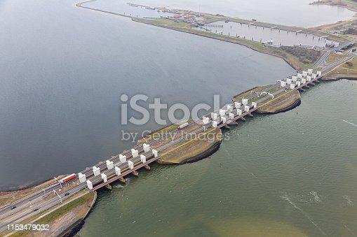 Aerial view Dutch Stevinsluizen near Den Oever, lock complex in Afsluitdijk and separation between fresh water lake IJsselmeer and salt Wadden Sea