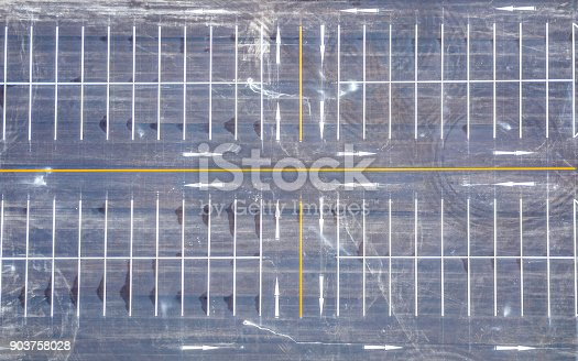 618059920 istock photo Aerial view empty parking lot 903758028