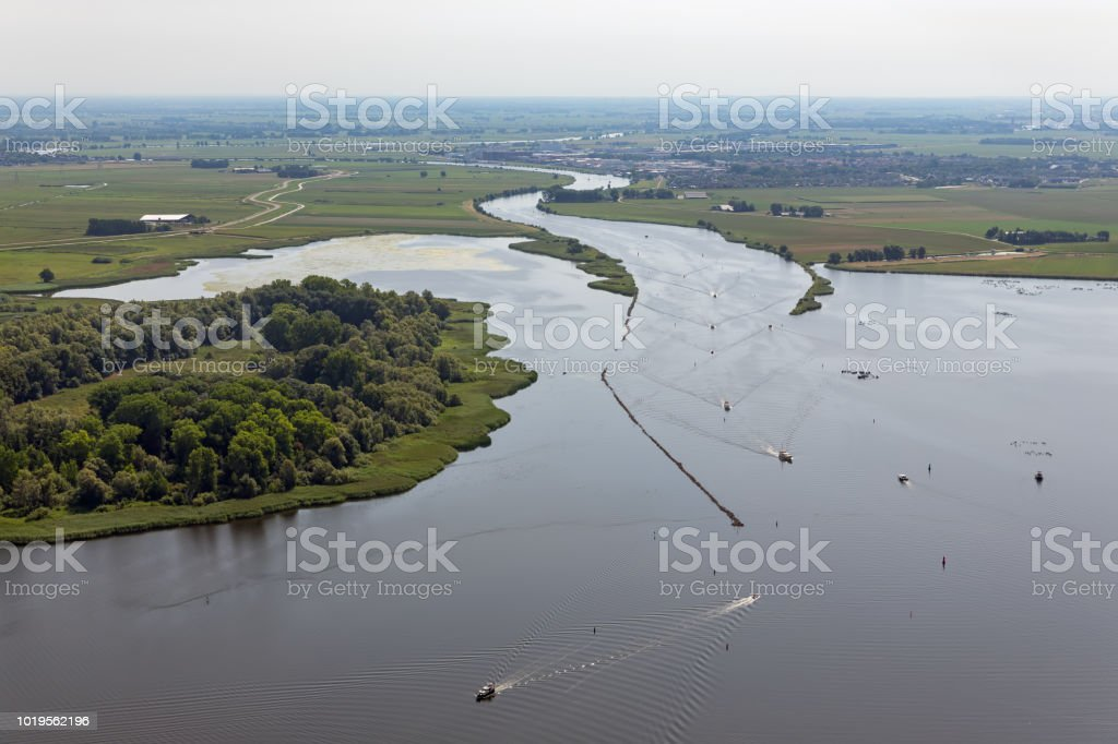 Aerial view estuary of Dutch river Vecht with sailing ships stock photo