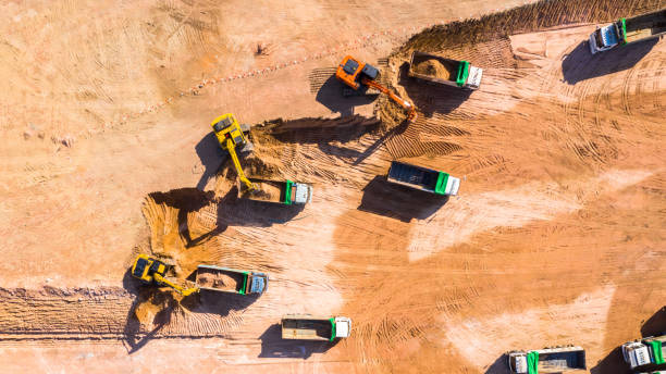 Aerial view excavator working on a construction site. stock photo