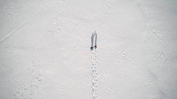 aerial view family snowshoeing outdoor in winter - raquette photos et images de collection