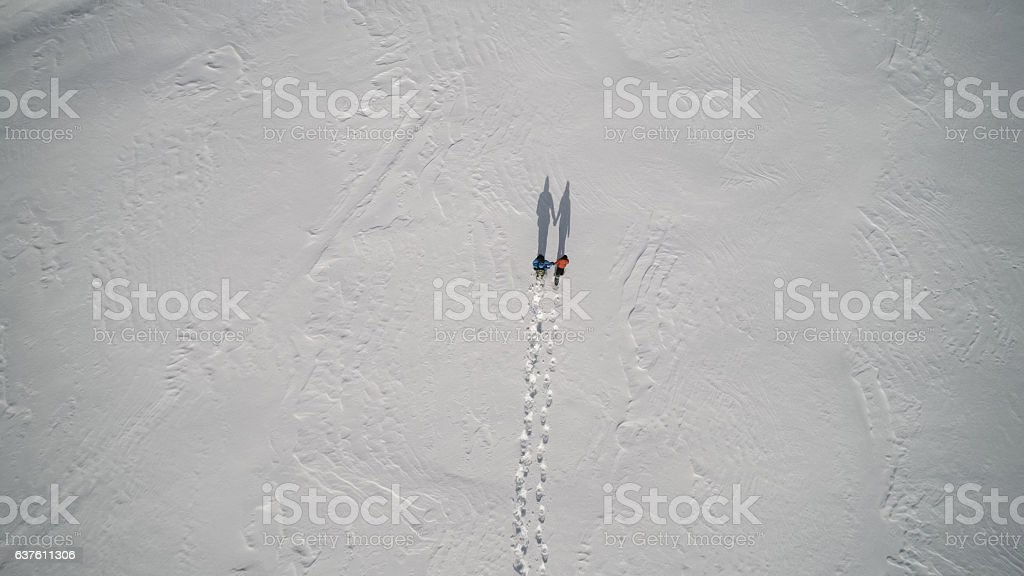 Aerial View Family Snowshoeing Outdoor in winter stock photo