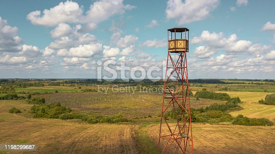 Aerial view fire watch tower in agriculture field. Fire safety and travel concepts.