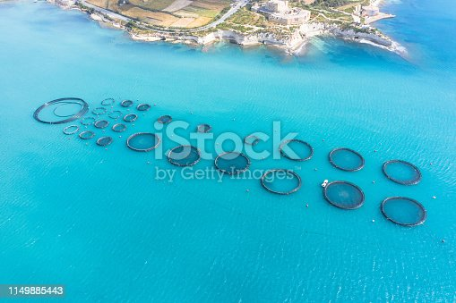 Aerial view fish farm with floating cages in the Mediterranean sea
