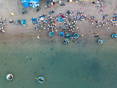 Top view, aerial view fishing harbour market from drone. Royalty high quality free stock image of market at Mui Ne fishing harbour or fishing village. Fishing harbor is a popular tourist destination