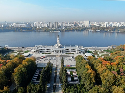 Aerial view flight over the passenger terminal in port. The new building of the Northern River Station in Moscow from a height on a clear day in autumn