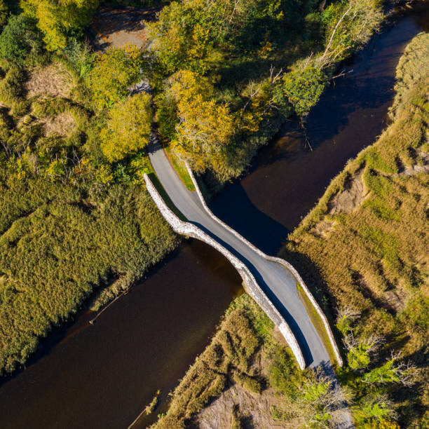 Aerial view from a drone of an old stone bridge in Dumfries and Galloway south west Scotland The view from a drone of an old stone bridge crossing a small river that flows into an estuary in Dumfries and Galloway, south west Scotland. johnfscott stock pictures, royalty-free photos & images