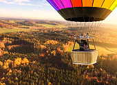 istock Aerial view from a hot air balloon with loving couple 1283679278