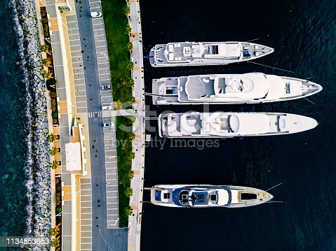 1066331604 istock photo Aerial view from above at the luxury yachts in the marina 1134853653