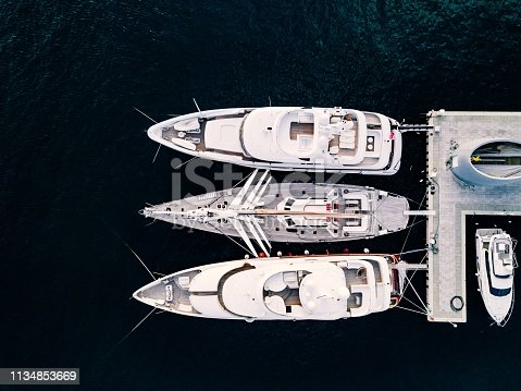 1066331604 istock photo Aerial view from above at the luxury yachts in the marina 1134853669