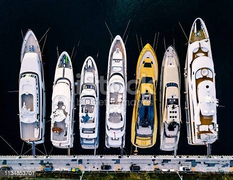 1066331604 istock photo Aerial view from above at the luxury yachts in the marina 1134853701