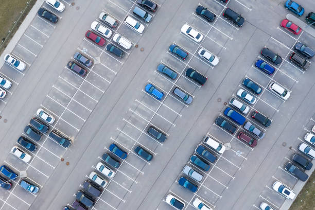 Aerial view from above - car parking in a residential area of the city. Aerial view from above - car parking in a residential area of the city parking lot stock pictures, royalty-free photos & images
