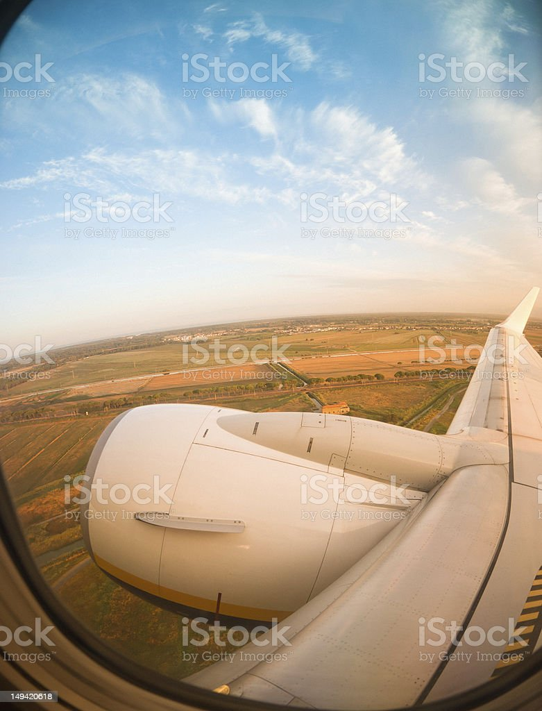 aerial view from airplane porthole at sunset - fisheye lens royalty-free stock photo