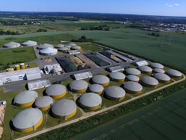 Aerial view from big biogas plant in green fields stock photo