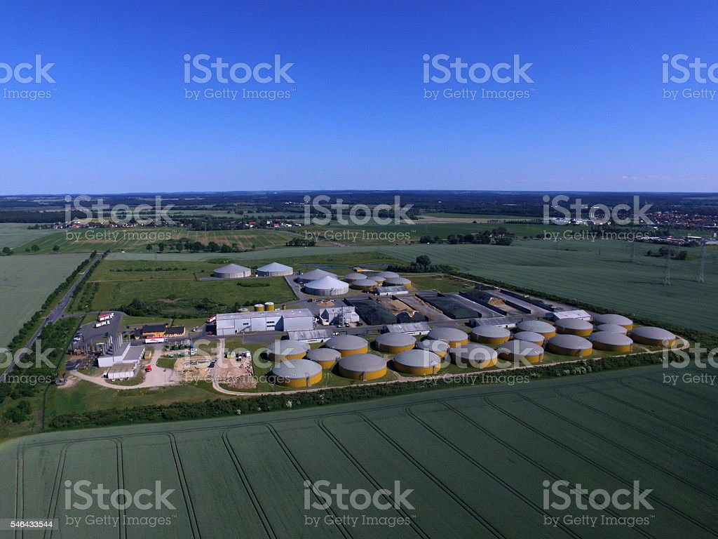 Aerial view from big biogas plant in green fields - Photo