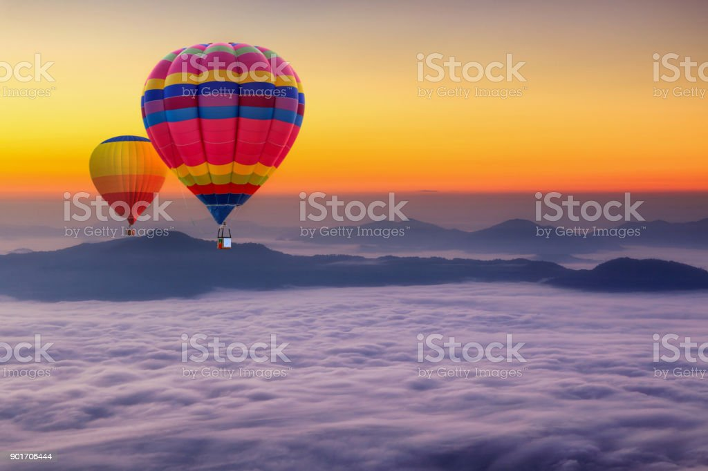 Aerial view from colorful hot air balloons flying over with the mist at Pha Tung mountain in sunrise time, Chiang Rai Province, Thailand stock photo