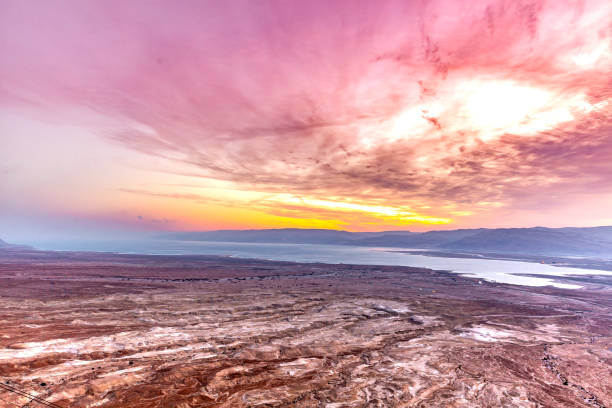 Aerial View from Mountain on Negev Desert, Israel This pic shows  Negev Desert in israel at early morning. Colorful clouds and sky is seen in the pic along with desert landscape. The pic is taken in early morning time and in January 2019. negev stock pictures, royalty-free photos & images