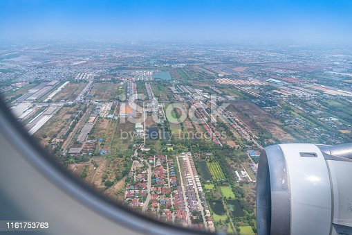 When on the plane before reaching Suvarnabhumi Airport looking down from the window of the plane will see the landscape of Thailand.
