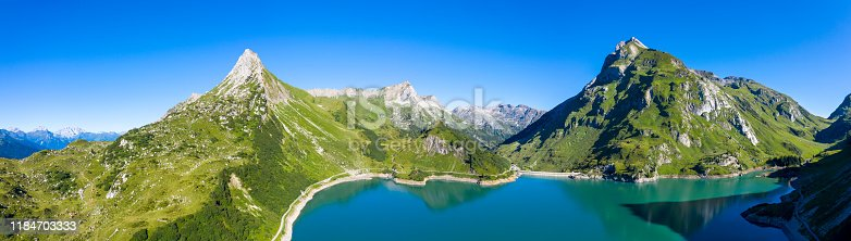 Aerial view from the Spullersee reservoir and the Lech valley in Vorarlberg, Austria. HDR panorama with extremely high resolution shot by a drone.
