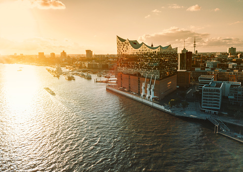 aerial view from waterside on Hamburg Hafen City at sunset hour