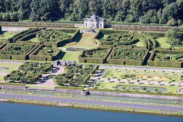 aerial view gardens chateau freyr along river meuse in belgium - maasvallei stockfoto's en -beelden