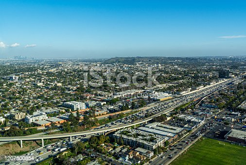 istock Aerial View high above the 405 Freeway in Los Angeles looking East 1207800854