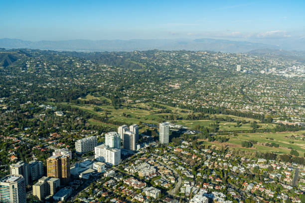 Aerial view high above Wilshire Blvd and the Los Angeles County Golf Course in Los Angeles Aerial view high above Westwood, Beverly Hills, Wilshire Blvd and the Los Angeles County golf club looking North towards the Hollywood Hills, Benedict Canyon westwood neighborhood los angeles stock pictures, royalty-free photos & images