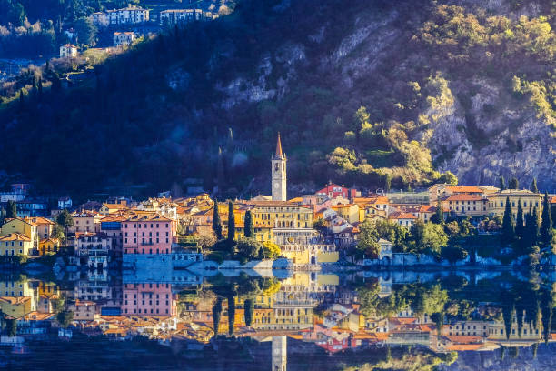 aerial view in sunries of the village in lake como - italy - lake como stock photos and pictures