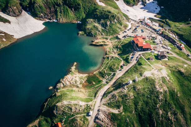 Aerial view Lake Balea on Transfagaras pass in Carpathian mountains Romania stock photo